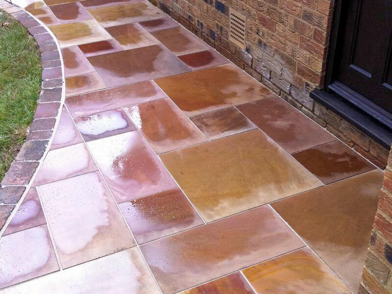 Wet paving laid in irregular shape outside a front door